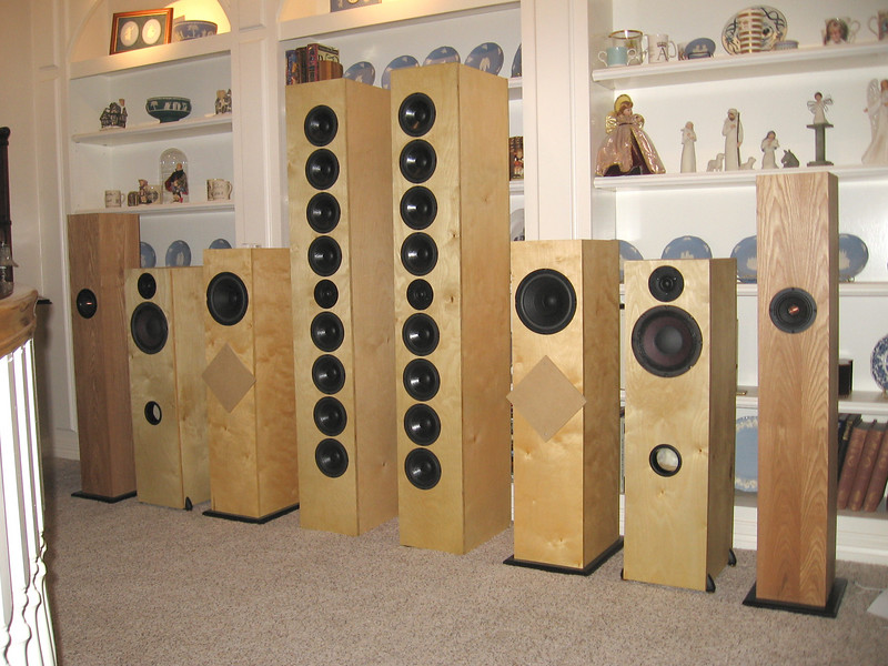 "From outside working toward the center, 1) Jim Griffin single driver MLTL bipoles, 2) Tower version of the Pi Speakers Studio One speaker, 3) Single driver speaker using 8"" full range Pioneer driver, 4) the ART Array line array speaker."