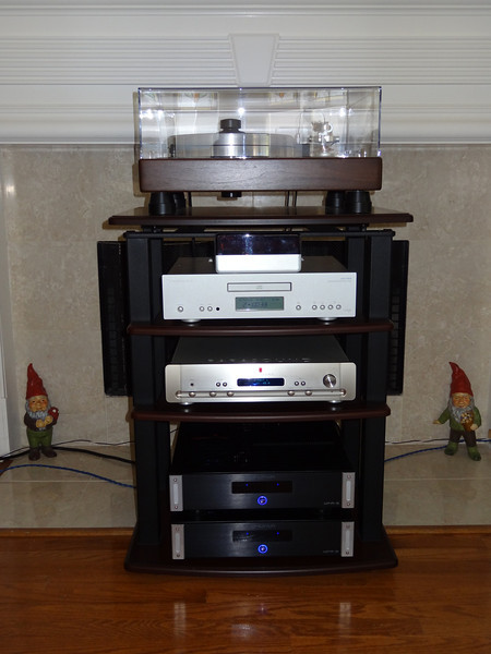 Passive bi-amping using two Emotiva Audio UPA-2 stereo amps. This system is guarded 24/7 by ninja garden gnomes.