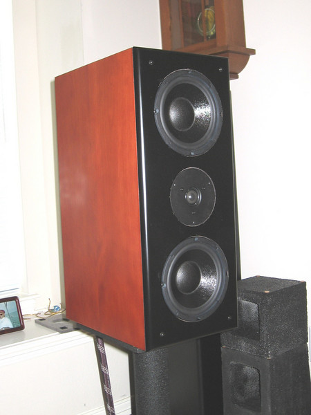 "The AudioFred 2 MTM incorporates two 6.5"" midwoofers with a single 1.125"" silk dome tweeter. Crossover parts include air core inductors, metallized polypropylene capacitors, and non-inductive resistors. The one cubic ft rear-ported enclosure is finished in a furniture-quality cherry veneer. A grill with magnetic fasteners is included to discourage curious fingers."
