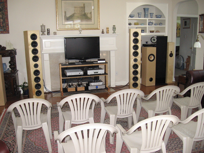 Setup for the 11/14 Houston Audio Society speaker comparison. Shown in playing position are the Art Array line arrays. Standing by are the Brines Acoustics TT-2000's, the Magnepan MMG's, and the Jim Griffin MLTL single driver bipoles with supertweeter. Equipment includes a Cambridge Audio 840C CD player and a Krell KAV-400xi integrated. Also included on the bottom shelf for the flea power crowd is a Musical Experience tube preamp and a pair of Bottlehead Paramour SET monoblocks.