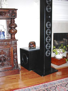 "The subwoofer behind the Anorexiarray is an older Advent sub whose foam surround 10"" driver recently bit the dust. The replacement driver shown is a 10"" Dayton sheilded DVC which fit into the 1.5 cu ft enclosure nicely in a sealed configuration. In room response is flat to about 25hz."