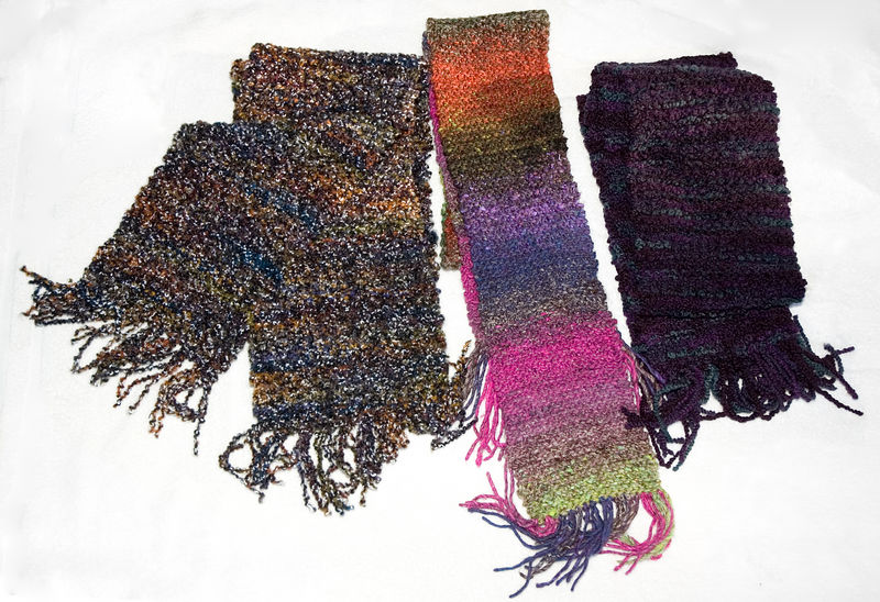 Christmas scarves, Dec 2005.  Distinctive, imported yarns did all the style work. All garter stitch.
