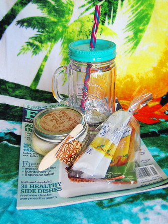 A little something to start their summer.  <br /> A cute summer cup, some drink packets, coconut sugar scrub and a magazine.
