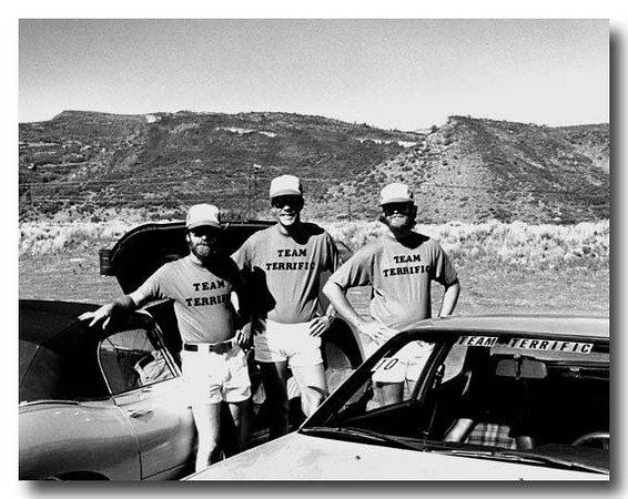 Long before the current day Team Terrific Vintage Racing team, the first first Team Terrific team was formed. It was at Woody Creek Raceway in Aspen.  Bob Alder, John Cormey, and my brother Bruce Alder were the original team photographed here in about 1978.  (Yes, that is me on the left.).  For a number of years Bob and John participated in the Rocky Mountain Jaguar Club (RMJC) events in Aspen, me with my E-Type and John with his cars (a Porsche 944 here).  Ted Hummell organized these track days for RMJC.  One year my brother Bruce joined in the fun, renting a Rabbit (not shown).  Sometime during the weekend, John hatched the idea of calling ourselves Team Terrific, went into town, bought the T-shirts, and a legend was born.   And yes, alcohol was involved. <br><br>Team Terrific still lives today.   What great fun we had in those early days.