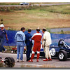 Another nice picture of being on the grid at Steamboat in 1989.  At left in the RMVR shirt is Gary ?, then me, Scott Krista in red driver's suit, and Jimmy Steinmetz in white togs.  Scott's Lola is in lower left of the picture.
