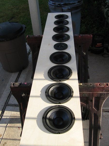 Here's one front baffle with all the drivers set in their cutouts. For ease of construction without a router the drivers are not recessed, but if you have access to a router it's better to recess them, especially the tweeter, to avoid baffle-edge diffraction.