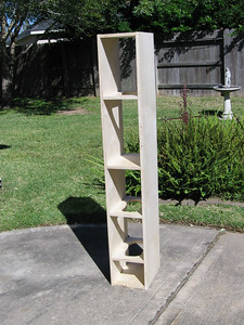 "Here's an enclosure with the top & bottom, solid center divider, and braces glued in. The center divider creates two separate equal volume chambers. Dividing this long enclosure into two chambers reduces the inclination to produce a ""pipe organ"" internal resonance. NOTE: I added another brace in the final prototype after this picture was taken, so the final plans include a brace between each two drivers."