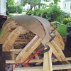 The twist in the plank is about the same at both ends, requiring ingenuity in use of clamps.