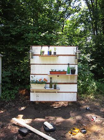 Added plants and wine bottle solar lanterns.