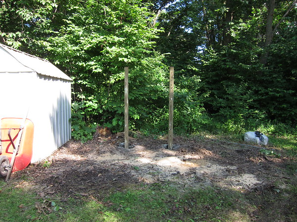 These are 8 foot 4x4 posts.  We dug holes 2 feet deep.