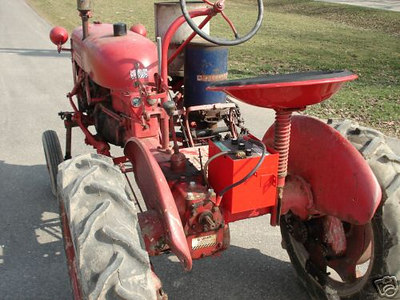 Farmall Cub in Marshfield, Wisc., with 172 planter and sidedresser. ebay