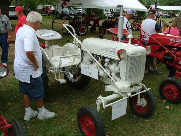This Farmall Cub, painted white, was used as a demonstrator. Later, when put up for sale, it was repainted red. Uploaded from farmallcub.com photo gallery. Owned by Mick and Carol Osterman of Groton, SD.