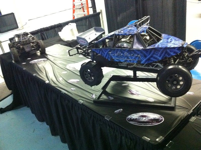 Turtle Racing setting up his trucks in our booth at RCX Chicago