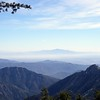 """View looking SE out past the east Twin Peak """"spine"""" (right ridgeline) to the still fairly easy to identify Santiago Peak near my home in south Corona, about 70 miles in the distance."""