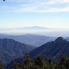 """View looking SE out past the east Twin Peak """"spine"""" (left ridgeline) to the still fairly easy to identify Santiago Peak near my home in south Corona, about 70 miles in the distance."""