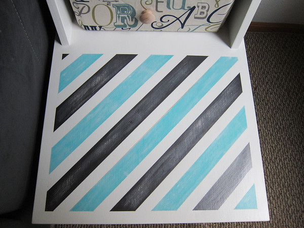 I lightly sanded the gray metallic stripes and I went over the teal stripes with a foam brush that had just a tiny about of white paint on it.  If you look closely you can see a tiny bit of yellow I missed on the second time around.  It didn't bother me so I left it.