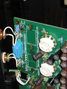 Here's a view of the topside of the board with the stock caps removed. Notice there are two holes for connecting each cap lead. You can use the inner holes to attach bypass caps if you are using them. If you have a solder sucker it should be used to clean out the holes before installing the Sonicaps.
