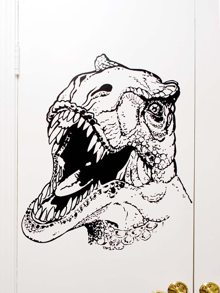 2 foot by 2 foot T-Rex dinosaur head I did for my nephew's room. Black Vinyl on a closet door.