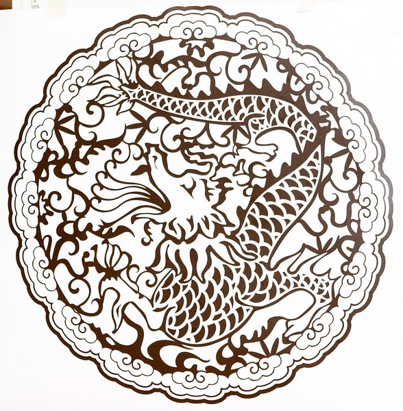 Large dragon design (~13.5 inches in diameter) in brown wall vinyl.