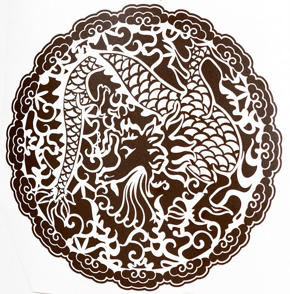 Small dragon design (~7 inches in diameter) weeded in reverse.