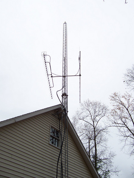 Antennas down for maintenance, adding turnbuckle and cable to help support the three hard lines. Cold and windy day. 11/9/08