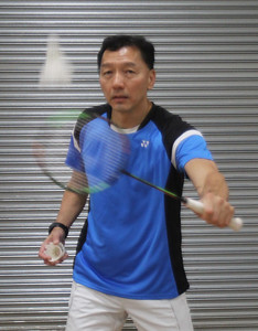 Badminton coach Andy Chong of Acton and young players at Mill Works in Westford. (SUN/Julia Malakie)