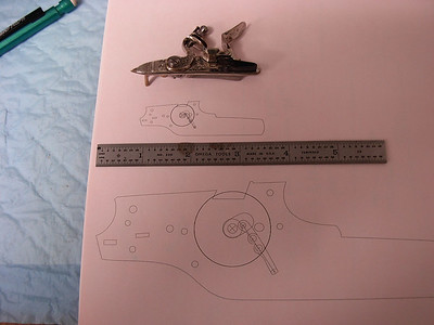 I have drawn all the parts in the full size locks and scaled the full size drawings to 1/3 scale. The lock in photo is a 1/2 scale Siler , the full size and 1/3  drawings of the side plate show the chain and tumbler. The 1/3 side plate will be 2.6 inches long ,chain length will be .362 inches long. Tomorrow I'll start machining side plate and chain parts. Stay tuned