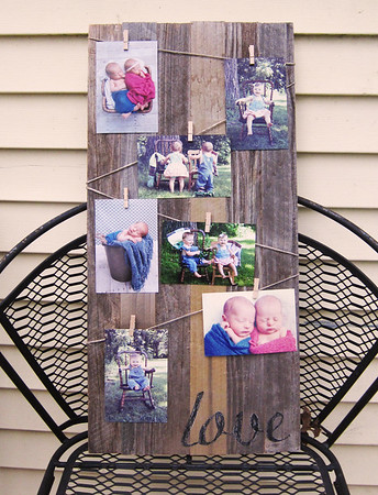 A barn wood photo display.  This turned out so cute!