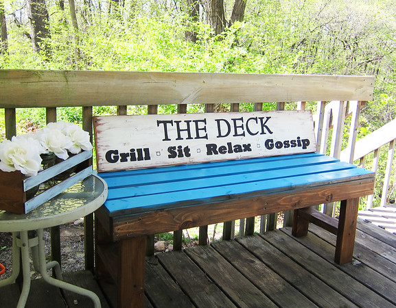 A sign I made for the deck out back.  This is wood siding from a house that was being fixed up.  This piece measures 45 inches long.  And I have more out in the garage!!  There are a couple of really cool pieces that have the house number on them.