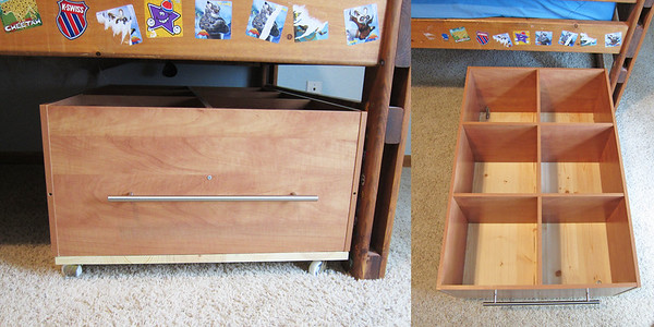 "I was so excited about this project!! Trevor has a loft bed and we store a lot of toys under it. But, sometimes it's a hassle and a mess because it's hard to reach the stuff way at the back. So I made this!! I took a closetmaid cubby shelf (24x36) attached it to a 3/4"" piece of wood, same size. Added a handle to the front and wheels at the bottom. It rolls nice and easy and now they can reach all their toys! This stands about 14 inches high, so your bed would need to be at least that far off the ground for this.  This holds so many toys!"