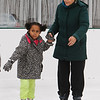 Winter Ice at The Point. New rink behind Tavern in the Square opens for ice skating and Community Appreciation Day. Zizi Abrams, 4, of Norwood, skates with her grandmother Jessica Ronalds of Acton. It was Zizi's first time skating. (SUN/Julia Malakie)