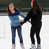 Winter Ice at The Point. New rink behind Tavern in the Square opens for ice skating and Community Appreciation Day. Evy Kaiser, left, and Stella Austin, both 12 and from Littleton. (SUN/Julia Malakie)