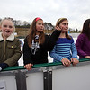 Winter Ice at The Point. New rink behind Tavern in the Square opens for ice skating and Community Appreciation Day. From left, Paige O'Keeffe , Evy Kaiser, Stella Austin, and Emma Letendre, all 12 and from Littleton. (SUN/Julia Malakie)