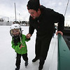 Winter Ice at The Point. New rink behind Tavern in the Square opens for ice skating and Community Appreciation Day. Kayson MacMillan, 4, of Acton, skates with his father Chris MacMillan. (SUN/Julia Malakie)