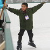 Winter Ice at The Point. New rink behind Tavern in the Square opens for ice skating and Community Appreciation Day. Brodi  Prost, 8, of Littleton goes skating for the first time. (SUN/Julia Malakie)