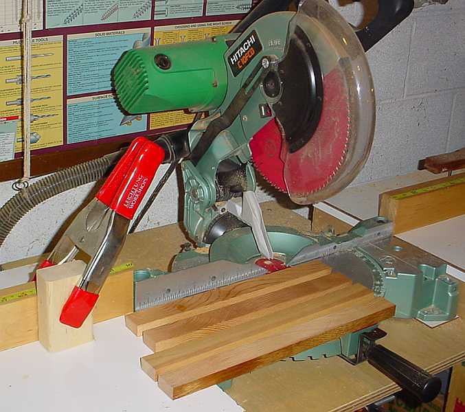 Should have been first pic of 3rd day - inside strips, front & back cut @ the miter saw - notice the stop/clamp, i.e. measure once, check, and then do repetitive cuts QUICKLY!