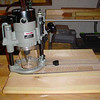Plunge router w/ spiral up-cut bit on circle jig