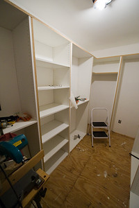 "Left side with middle shelves and 4 ""short hanging"" sections."