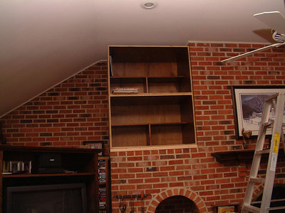 Cabinets set in place/attached to brick.