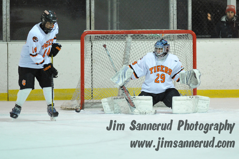 Chris Stangarone #29 making one of his 38 saves in the game. White Plains High School Tigers varsity ice hockey team upset the defending NY State champion Suffern Mounties 3-2 in overtime at Ebersole Ice Rink on Thursday, December 6, 2012