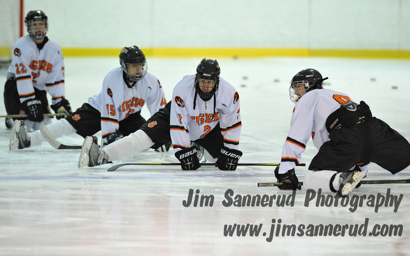 Team captain Kevin McGee #8 leading the team in pre-game stretches. White Plains High School Tigers varsity ice hockey team upset the defending NY State champion Suffern Mounties 3-2 in overtime at Ebersole Ice Rink on Thursday, December 6, 2012