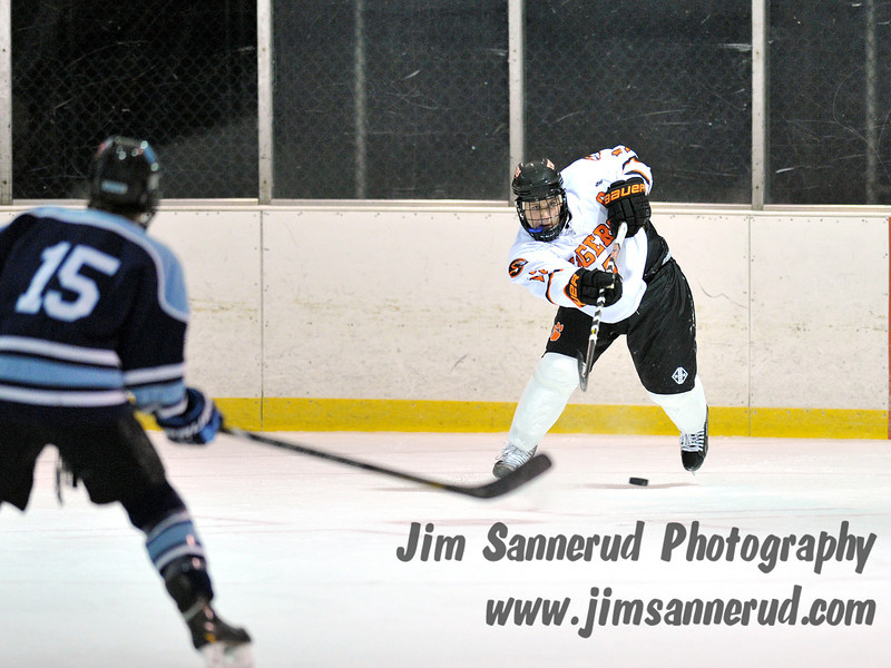 Chris Medeot #17 firing the puck down the ice on a penalty kill. White Plains High School Tigers varsity ice hockey team upset the defending NY State champion Suffern Mounties 3-2 in overtime at Ebersole Ice Rink on Thursday, December 6, 2012
