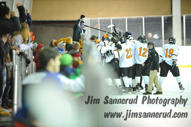 Players and fans celebrate the Tigers' victory. White Plains High School Tigers varsity ice hockey team upset the defending NY State champion Suffern Mounties 3-2 in overtime at Ebersole Ice Rink on Thursday, December 6, 2012