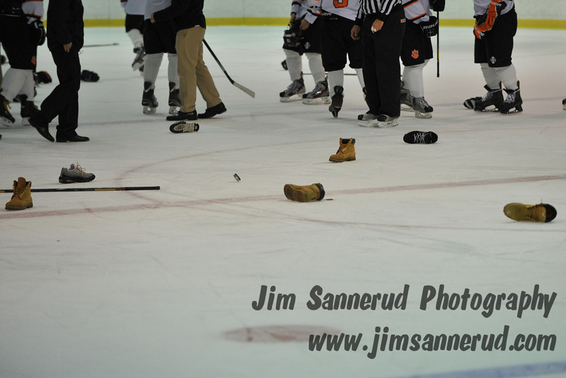 Throwing boots on the ice is some kind of crazy tradition. White Plains High School Tigers varsity ice hockey team upset the defending NY State champion Suffern Mounties 3-2 in overtime at Ebersole Ice Rink on Thursday, December 6, 2012
