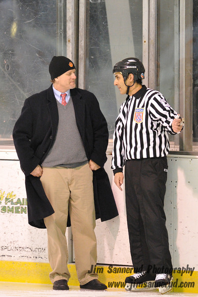 Head coach Howard Rubenstein having a friendly chat with the referee before the game. White Plains High School Tigers varsity ice hockey team upset the defending NY State champion Suffern Mounties 3-2 in overtime at Ebersole Ice Rink on Thursday, December 6, 2012