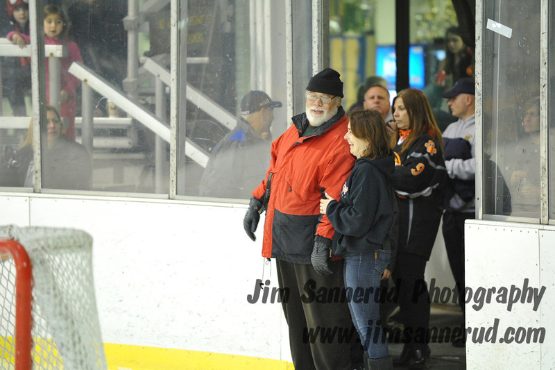 Retired coach Guy Mathews was honored by having the team's new locker room dedicated to him. White Plains High School Tigers varsity ice hockey team upset the defending NY State champion Suffern Mounties 3-2 in overtime at Ebersole Ice Rink on Thursday, December 6, 2012