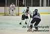 Defenseman Kelsey Fee #24 denies Mounties #11 John Costa a good scoring opportunity. White Plains High School Tigers varsity ice hockey team upset the defending NY State champion Suffern Mounties 3-2 in overtime at Ebersole Ice Rink on Thursday, December 6, 2012