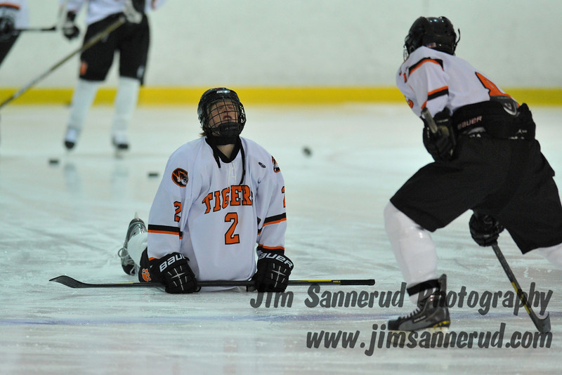 Tommy Bertram #2 doing some pre-game stretching. White Plains High School Tigers varsity ice hockey team upset the defending NY State champion Suffern Mounties 3-2 in overtime at Ebersole Ice Rink on Thursday, December 6, 2012