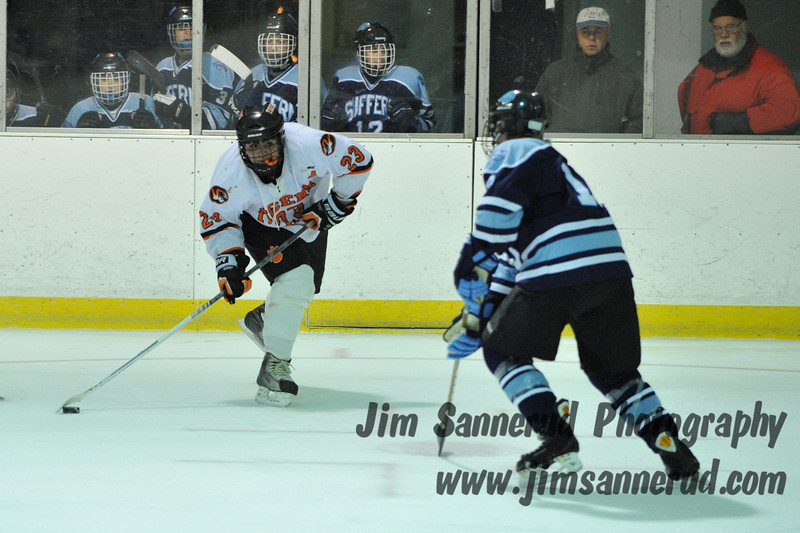 Phil Variano #23 prepares to fire a wrist shot. Suffern had too many players to fit on their bench. White Plains High School Tigers varsity ice hockey team upset the defending NY State champion Suffern Mounties 3-2 in overtime at Ebersole Ice Rink on Thursday, December 6, 2012