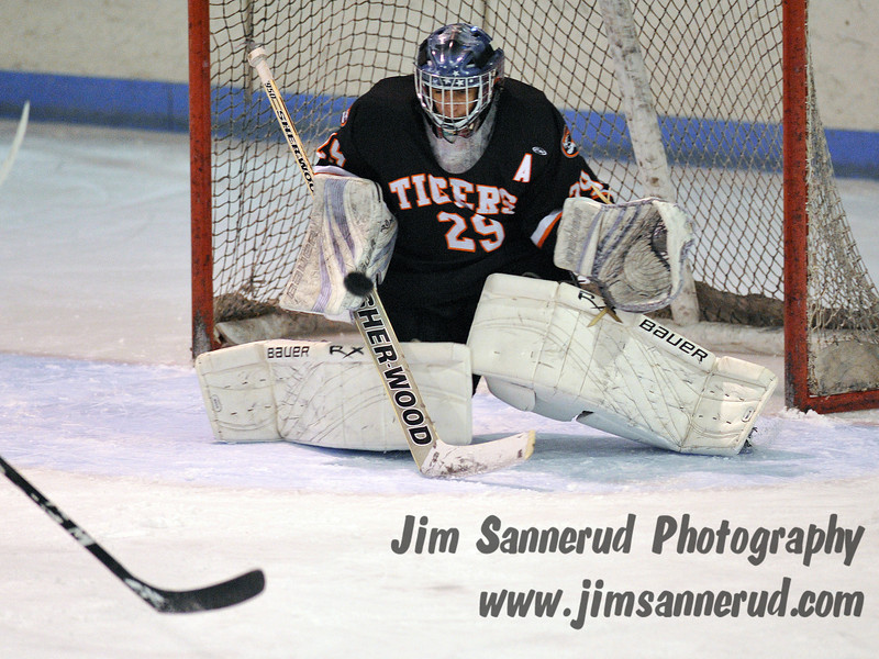 White Plains sophomore goaltender Chris Stangarone making one of his 37 saves. White Plains High School Tigers vs. Mamaroneck Tigers Varsity Ice Hockey at Hommocks Park Ice Rink, Friday, December 21, 2012, White Plains lost 3-1